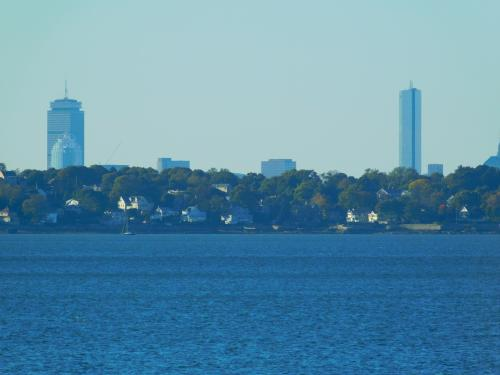 Skyline of some of Boston from a distance. the Prudential is on the left and the Hancock on the right.